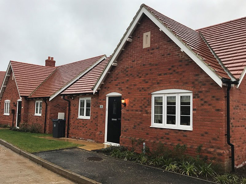 brick bungalow with new red roof tiles